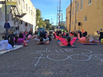 (Photo/ facebook.com/MobileStreetsAlive) Yoga in the the street? The pavement belongs to pedestrians during Mobile Streets Alive Sunday Oct. 18.