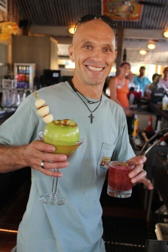 Trea Melville of LuLu's in Gulf Shores, winner of the 2015 Gulf Coast Bartender of the Year Competition, poses with his signature cocktail at LuLu's on Monday, Aug. 31. Melville advances to the state competition in Birmingham on Sept. 28. (submitted photo)