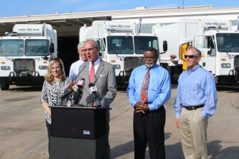 Mayor Sandy Stimpson announces the arrival of four new garbage trucks Wednesday morning, while councilors, from left, Bess Rich, Joel Daves, Fred Richardson and John Williams look on.