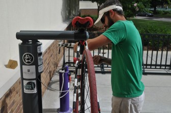 (Photo/Lagniappe) Thomas Carpenter of the Delta Bike Project demonstrates newly installed fix-it stations.