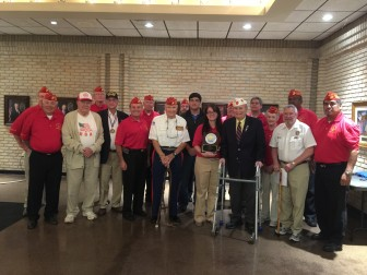 Kenya Thomas is pictured with former Fairhope Veterans of the Year and with members of the Jesse Andrews Jr. Detachment Marine Corps League.