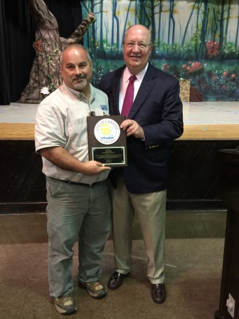Fairhope Mayor Tim Kant, right, presents a plaque to the city's 2015 Employee of the Year, Tim Manuel.