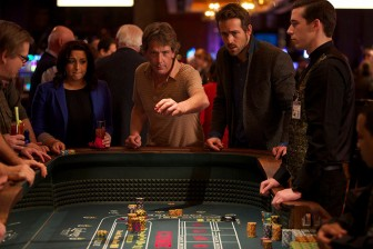 (Photo/ (Sycamore Pictures) Mississippi Grind) Ben Mendelsohn and Ryan Reynolds try their luck in 'Mississippi Grind.'