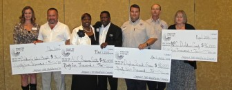 The 2015 Impact 100 grant winners are, from left: Baldwin County Foster and Adoptive Parent Association -  Katy Bridges and Kevin Welch; AUC Resource Center - Cassandra Boykin and Pastor Jerry Boykin; Daphne Search and Rescue - Lt. Joshua Gibbs and Capt. Ronny Champion; ARC Baldwin County - Kathy Fleet.