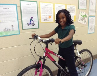 (Photo/Courtesy of Delta Bike Project) Gilliard Elementary School 4th grader Courtney Amison won a bicycle through the Delta Bike Project's Read to Ride program.
