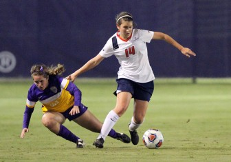 (Photo/University of South Alabama Athletics) South Alabama sophomore Danielle Henley outmaneuvers an LSU defender en route to a 4-0 shutout in the first round of NCAA tournament play in Mobile Nov. 14. The Jags advance to play Florida State in Tallahassee Nov. 20 at 4:30 p.m.