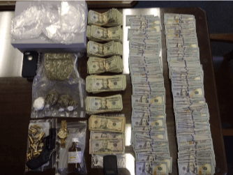 Cops seize gun, money in Marine Street drug bust