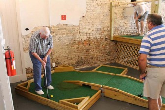 (Photo/ facebook.com/portcityminigolf) Port City Mini Golf on Conception Street in downtown Mobile boasts a locally themed, nine-hole indoor course and arcade games.