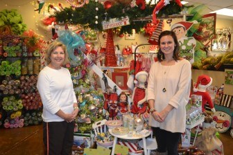 (Photos/ Courtesy of Semmes Women's Club) Semmes Christmas Tour Chair Terri Nelson visits with Meggie B's Christmas Store owner Robin Morse Byrd to admire the items she will be showing guests Dec. 12.