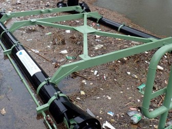 (Photo/Courtesy of Rob Nykvist) One of Mobile's two litter traps installed in the Dog River watershed appears filled with debris last year.