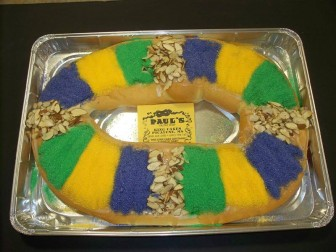 "(Photo | facebook.com/paulspastryshop) A king cake from Paul's Pastry Shop in Picayune, Mississippi. Though they sell them year-round, I was only treated throughout the Mardi Gras season. Boy, were they good. To this day when someone mentions the word ""Picayune"" I think of two things: Pawpaw's Camper City and king cakes."