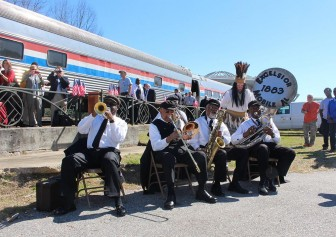 (Photo   Dale Liesch/Lagniappe) The Excelsior Band JOINED CHIEF SLAC IN welcomING an Amtrak inspection train to downtown Mobile Feb. 18, as part of a process aimed at BRINGING BACK passenger rail service to the Gulf Coast.
