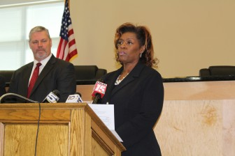 U.S. Attorney's Office Criminal Chief Vicki Davis addresses media during a press conference in Summerdale on Thursday.