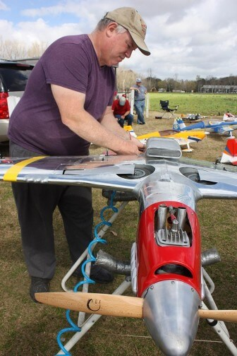 Courtesy of Robert DeWitt |  South Alabama Radio Controlled Modelers Club President Andy Woerner preps a scale model of a P-51 Mustang World War II fighter.