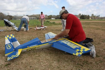 Courtesy of Robert DeWitt |South Alabama Radio Controlled Modelers Club member Loren Henry assembles an Edge 540 3D model to prepare it for flight.
