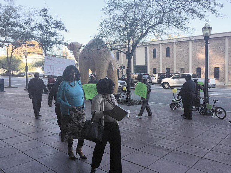 (Dale Liesch/Lagniappe) WAVE Protesters picketed outside Government Plaza Monday.