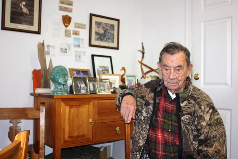 (Photo by Robert DeWitt) Author Tom Kelly in his Daphne office.