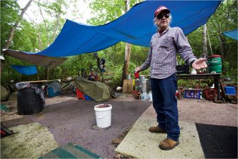 "(Photo | Daniel Anderson/Lagniappe) 70-year-old Will Ferrill has lived in campsites for more than 30 years. He believes the city of Mobile's forced evictions from private property north of downtown ""is going to be a big problem."""