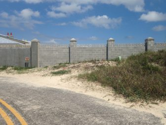 A 60-foot long concrete wall at the state's mansion in Fort Morgan caused controversy when Baldwin County Commissioners discovered it was constructed on a county right-of-way.