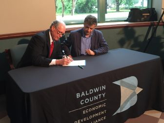 Bay Minette Mayor Bob Wills and Baglioni Group President Franco Tartaglino sign a proclamation welcoming Morganton Pressure Vessels to Bay Minette. (Eric Mann/Lagniappe)