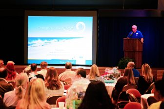 Herb Malone, president and CEO of Gulf Shores & Orange Beach Tourism, presents to more than 200 attendees at the organization's 2016 Tourism Summit at Erie Meyer Civic Center in Gulf Shores May 10. (Photo: Gulf Shores & Orange Beach Tourism)