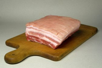(Photo | wikimedia.org ) Pork belly is simply uncooked, uncured bacon. Finding a slab and marinating it for tacos may prove to be a chore, but the results are well worth the effort.