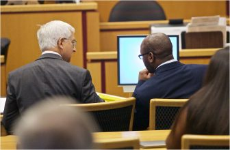 Attorney Jeff Deen, left, speaks with client Hiawatha Robinson Jr. (Dan Anderson)