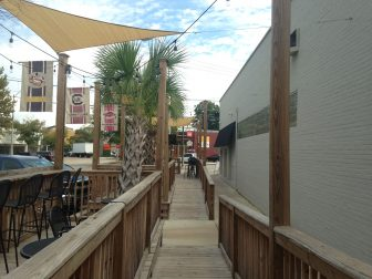 "(Photo|Lagniappe) ""Controlled"" outdoor spaces like the decks at Moe's (pictured) and Heroes will be exempt from the ABC Board's enforcement of outdoor alcohol service."