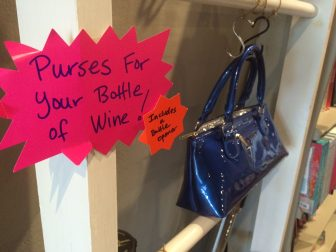 (Photo|Boozie Spy) Boozie is excited about the wine purse, insulated and complete with corkscrew, currently sold at Page & Palette in Fairhope.