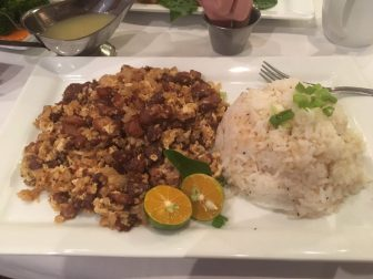 (Photo | Yelp) Dishes such as sigsig, a mix of diced pork, onions and chili peppers demonstrate the global influence of Filipino cuisine.