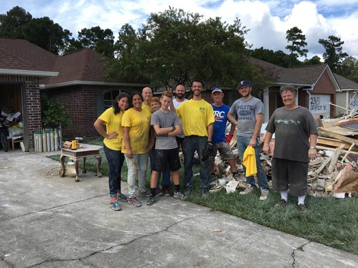 Volunteer members from the Daphne congregation, including three generations of the Boxx family, and two from the Evans family, form a work crew to work on flood damaged homes. From left: Ashlan Evans, Anne Evans, Greg Boxx, Zachary Boxx, Matthew Boxx, Edward Brewer, Chris Silva, Mark Boxx, Tanner Klippel and Fred Christensen.