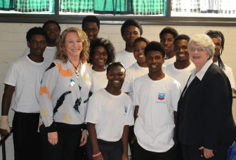 Mobile City Council President Gina Gregory and Superintendent Martha Peek with the Williamson High School robotics team. (Jason Johnson)