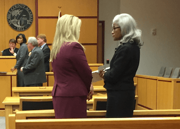 Left, District Attorney Ashley Rich speaks with Mobile County Commission President Merceria Ludgood following a November hearing. (Jason Johnson)