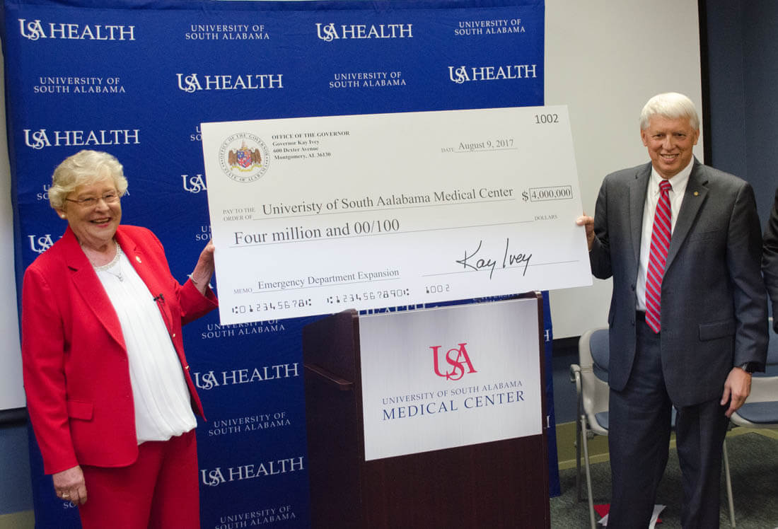 Alabama governor presents twice misspelled check to president of state university