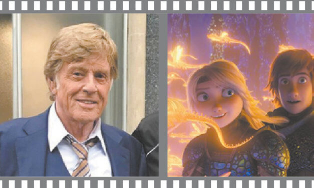 Robert Redford,  through a rear-view mirror