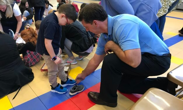 Baldwin Realtors donates 600 pairs of shoes to students