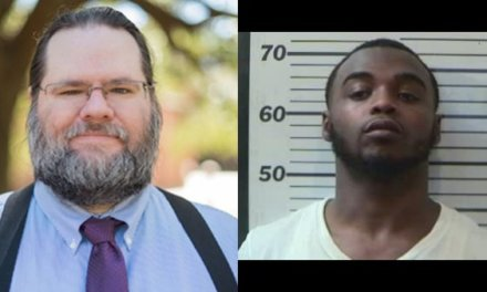 Third suspect charged in USA professor's murder